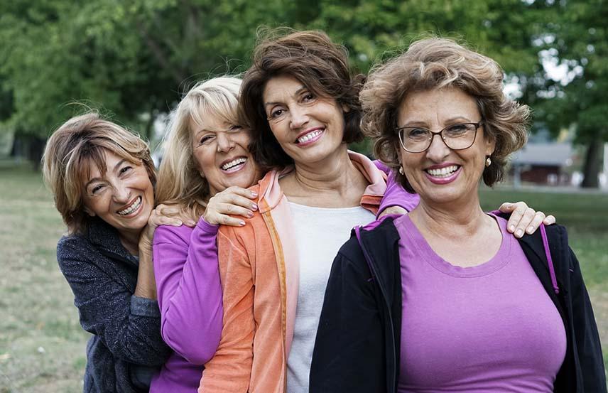 4 older women smiling