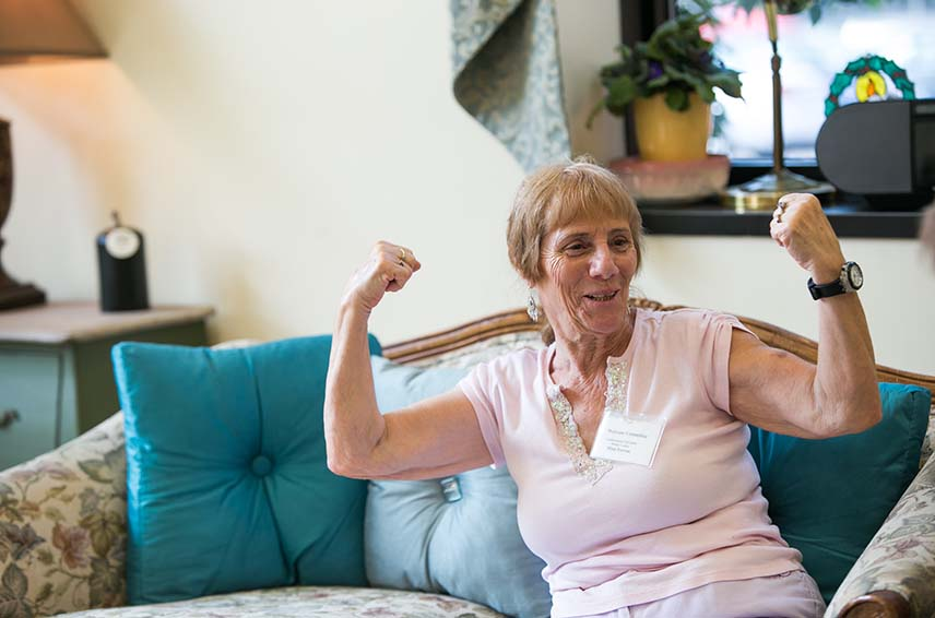 older woman posing with strong arms