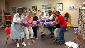Older adults with fitness balls at a library