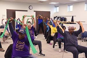 Older adults exercising with resistance bands at a library