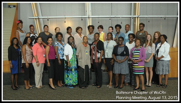 Group of women of color, with text 'Balitmore Chapter of W O C R N, Planning Meeting, August 13, 2015'