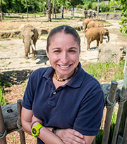 Daniella Chusyd smiling and posing with Elephants