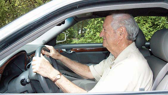 Older man with Alzheimer's driving a car