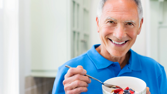 Older man eating high-fiber fruit