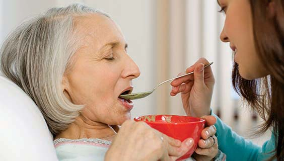 A person with late stage alzheimer's being fed healthy food