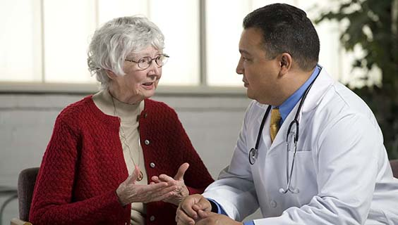Older woman communicating with her doctor