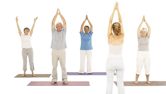 Group of older adults doing yoga