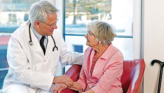 Doctor talking to an older woman about aging