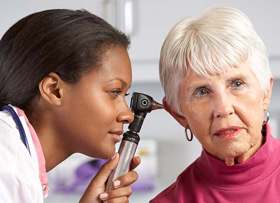 Doctor checking a patient's ears