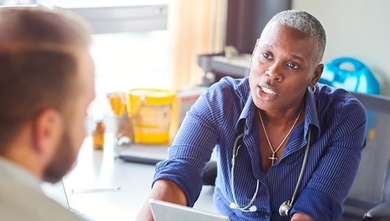Female African-American doctor talking about HIV/AIDS