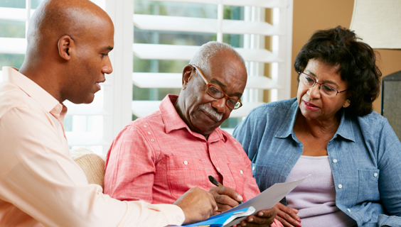 Older couple getting help with legal and financial documents