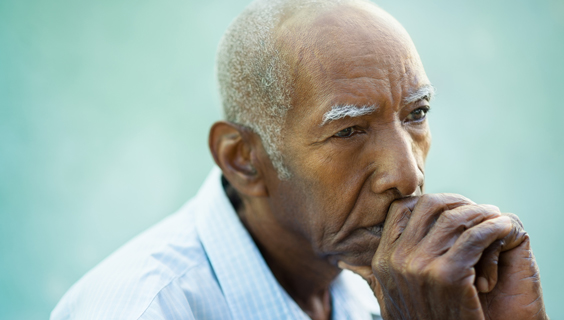 Older man mourning the death of a spouse