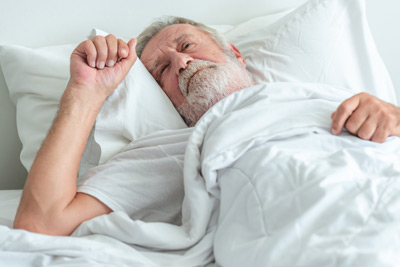 Older adult man lying bed who cannot sleep.