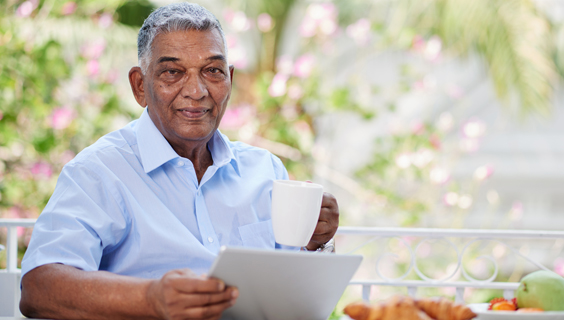 Older man reading about prostate problems