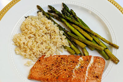 Grilled salmon, steamed brown rice, and sautéed asparagus.