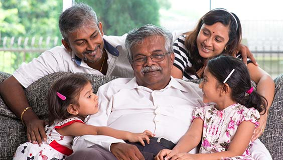 Indian man with his 2 children and 2 grandchildren
