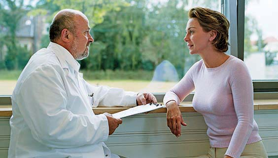 Doctor and nurse discussing treatment of frontotemporal disorder