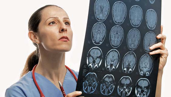 Female researcher looking at a brain scan