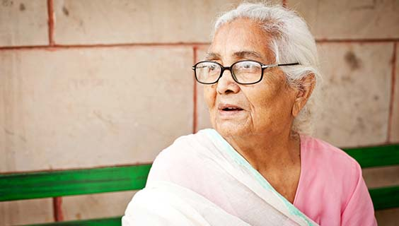 Older woman with glasses wearing a sari