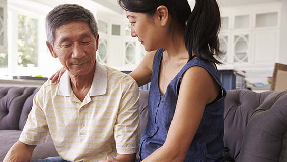 Asian woman having a serious talk with her father