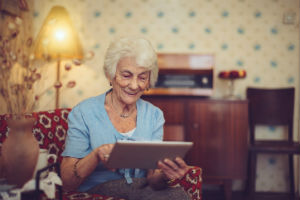 Older woman using aging-in-place technology