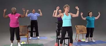 Group of older adults exercising with a trainer