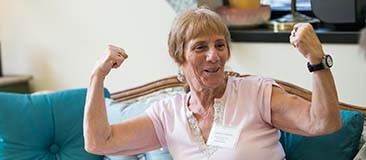 Older woman making muscles with her arms
