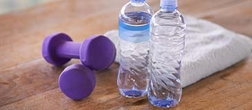 Weights, water bottles, and towel