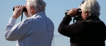 Men looking through binoculars