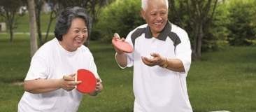 Older adults playing ping pong