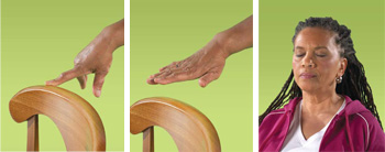 Woman with her hand on a chair, one finger on a chair, then her hand hovering over a chair.