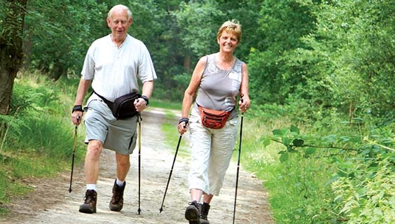 Couple hiking with poles