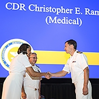 Dr. Ramsden shaking hands with Acting Surgeon General, Rear Admiral Sylvia Trent-Adams, during promotion to Commander in the United States Public Health Service.