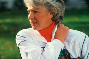 Woman with neck pain, one of the most prevalent sites of pain in older adults.
