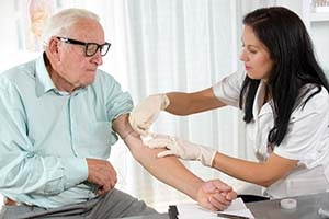 Older man having blood drawn