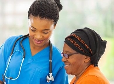 Nurse and female patient looking at a chart