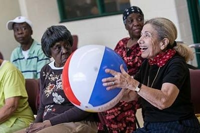 older adults playing with beach ball