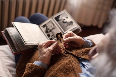 man looking at family album