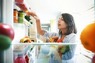 woman selecting food from the refrigerator