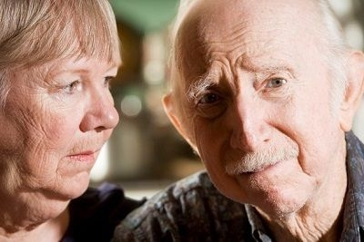 older wife and husband with Alzheimer's disease