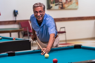 Happy man over 60 playing pool