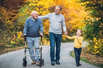 grandfather, father, and young son walking