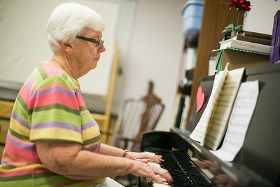older woman playing the piano