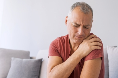 Older adult having shoulder pain