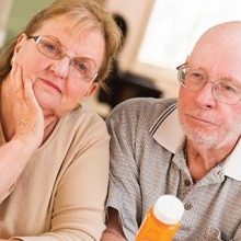 Older couple listening about the benefits, risks, and safety protections of clinical trials