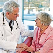 Doctor talking to older woman about aging