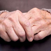Hands of an older adult with arthritis