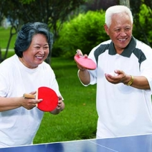 Older couple playing ping pong