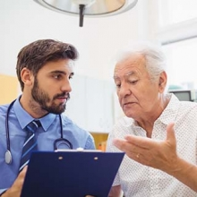 Older man talking with a medical specialist