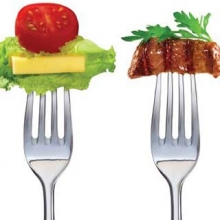 2 forks- one with lettuce, cheese and tomato; one with steak and herbs